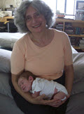 Ina Bransome with a very contented infant